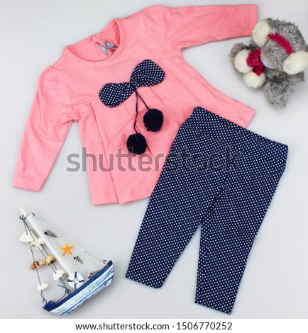 kids clothes, baby clothes, childs clothes and toys on white background