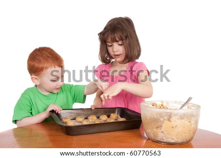 Kids counting chocolate chip cookies to bake. Isolated on white.