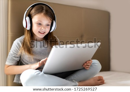 Kids distance learning. Cute little girl using laptop at home. Education, online study, home studying, technology, science, future, distance learning, homework, schoolgirl children lifestyle concept.