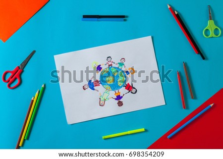 Kids draws with pencils and markers peace in the world. Child drawing the friendship of the peoples of the planet. Top view. #698354209