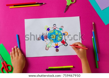 Kids draws with pencils and markers peace in the world. Child drawing the friendship of the peoples of the planet. #759467950