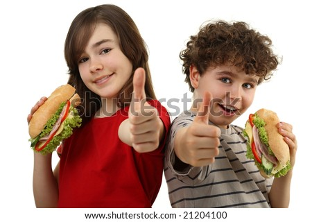 Kids eating healthy sandwiches isolated on white