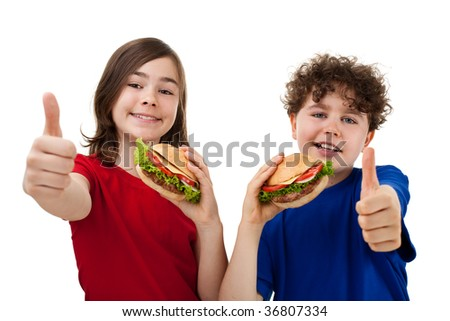 Kids eating healthy sandwiches showing Ok sign isolated on white background