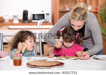 kids eating pancakes for breakfast
