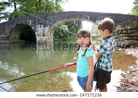 Kids enjoying fishing time in beautiful river