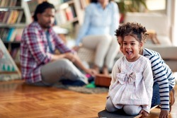 Kids enjoying the playtime with their parents in a cheerful atmosphere at home. Family, together, love, playtime