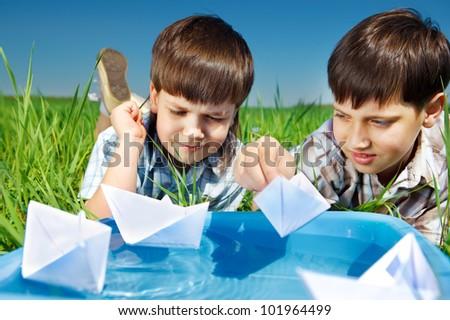 Kids enjoying their paper boat battles