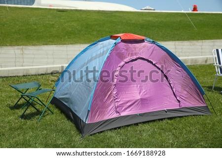 Kids festival . In park of Heydar Aliyev Center. Camping tent on green grass field