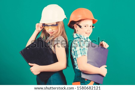 Kids girls planning renovation. Initiative children girls provide renovation their room green background. Child care. Renovation plan. Home improvement. Builder engineer architect. Future profession.
