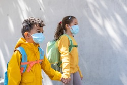 Kids Going Back to School Wearing Mask. Brother and Sister Going to School Together. Education Concept.