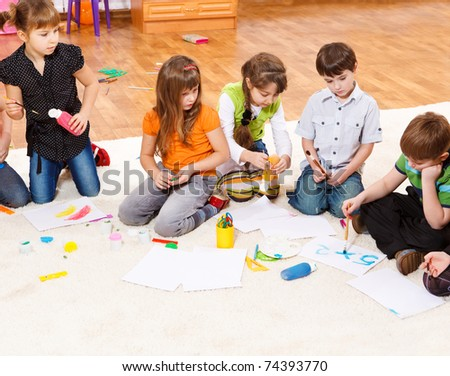 Kids group drawing and writing