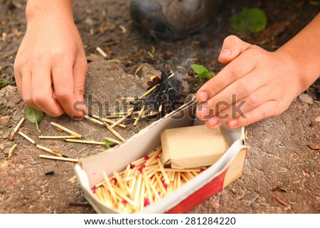 Stock Photo kids hand play with box of matches