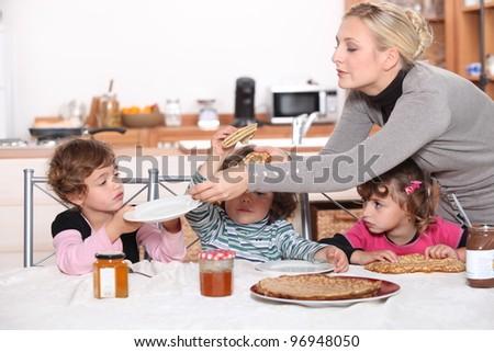 Kids having breakfast at home