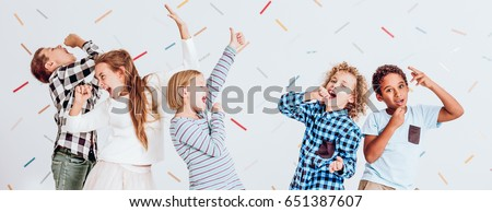 Kids having fun and happily singing at the party