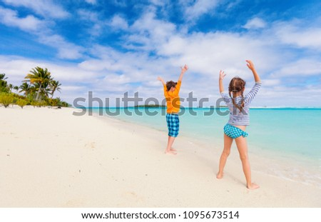 211f4453f7662 Kids having fun at tropical beach during summer vacation #1095673514