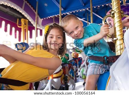 Kids having fun on a carnival Carousel Stock photo ©