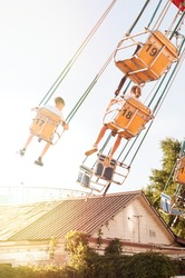 Kids having fun on summer school break. Funfair. Amusement park. Nostalgic. Summer vacation