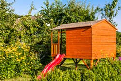 Kids house in the garden, playhouse, cottage for children's play