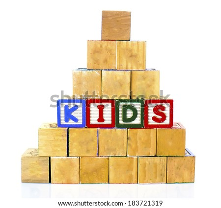 KIDS in alphabet wooden word blocks isolated on a white background