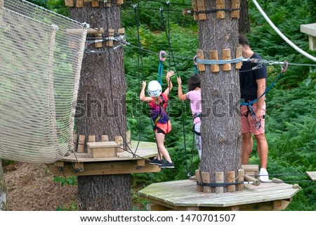 kids in an adventure park or wood park or  forest park
