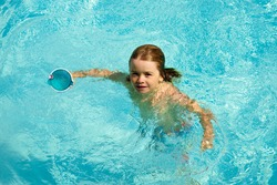 Kids in swimming pool. Children summer vacation. Summertime attractions concept. Swimmingpool