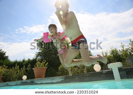 Kids jumping in swimming-pool