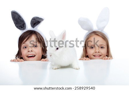 kids looking at their white...