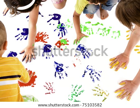 kids making colourful hand prints on white copy space
