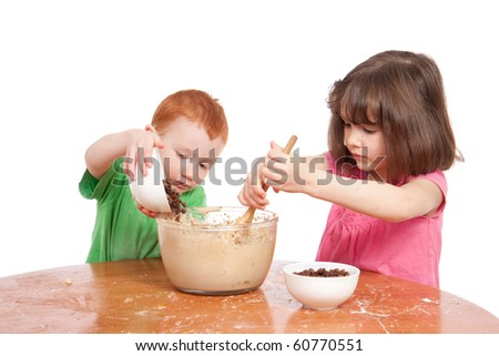 Kids mixing chocolate chip cookies