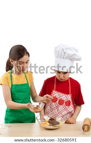 Kids mixing dough isolated on white background