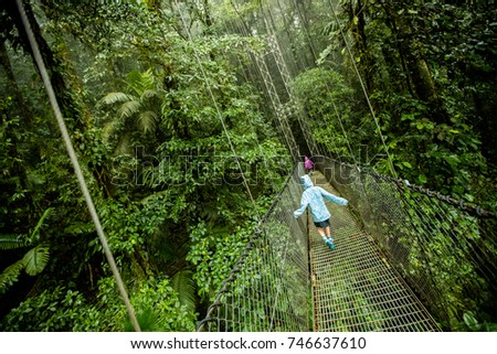 Kids on Canopy Tour through the rainforest in Costa Rica #746637610