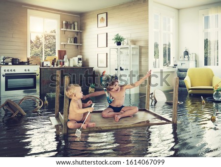 kids pday on the table while flooding in the kitchen. Photo and media photocombination Foto stock ©
