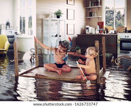kids pday on the table while flooding in the kitchen. Photo and media photocombination Stock photo ©