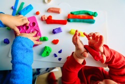 kids play with clay molding shapes, learning through play