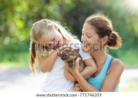 kids play with farm animals....