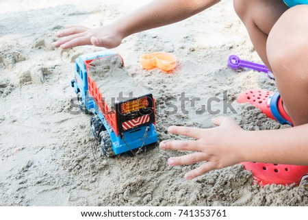 kids play with sand on summer beach #741353761