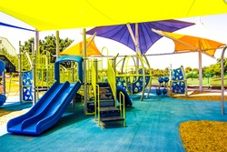 Kids Playground Equipment Covered By Colorful Shade Canopies