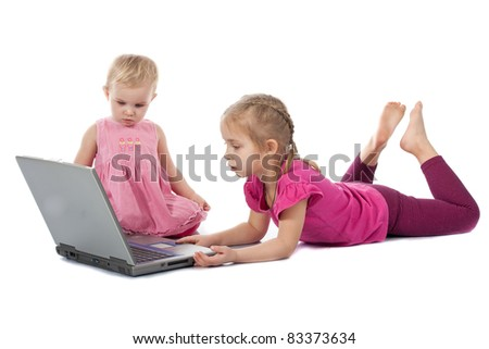 Kids playing computer game on laptop isolated on white