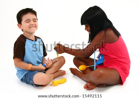 Kids playing doctor and patient.