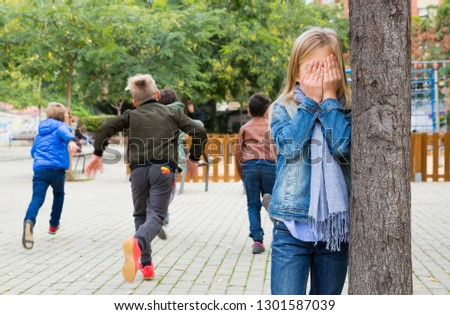 Kids playing hide and seek on the street