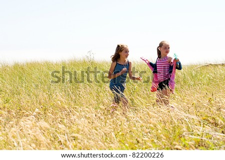 Kids playing in a field - stock photo