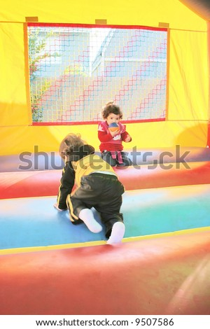 kids playing in inflatable air castle - stock photo