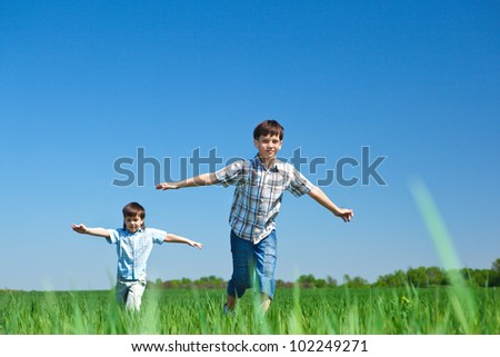 Kids playing in the meadow