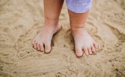 Kids playing in the sands. This activity is good for sensory experience and learning by touch their fingers and toes through sand and enjoying its texture.