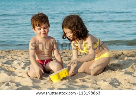 Kids playing on the beach - stock photo
