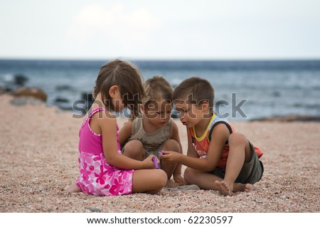 Kids playing on the beach.