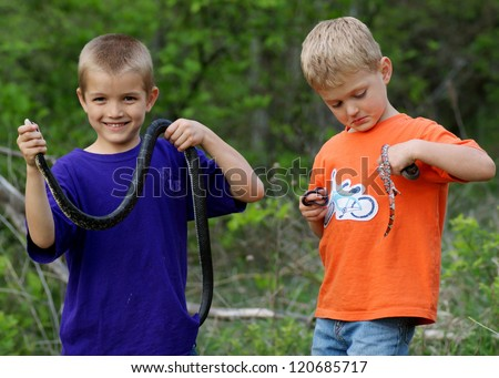 Kids playing outside, catching wild snakes - holding Black Rat Snake, Red Milk Snake, Eastern Yellow-bellied Racer and Western Worm Snake