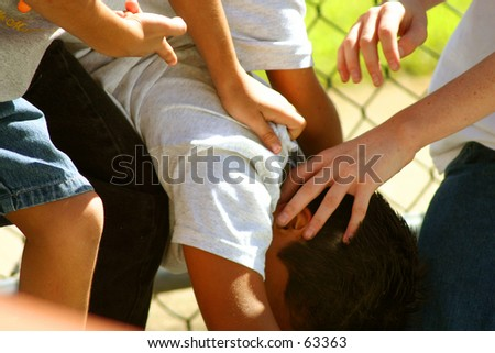 Kids playing Tough - stock photo