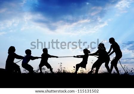 Kids playing tug war pulling rope