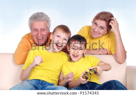 kids playing video games with grandparents